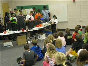 The Chemistry Club performs demonstrations for third-grade students.